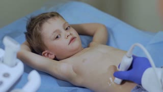 Doctor scan abdomen of little boy with medical utlrasound