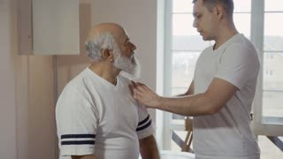 Doctor show his patient why he has a pain in shoulder