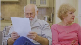 Elderly man calms and makes peace with his wife