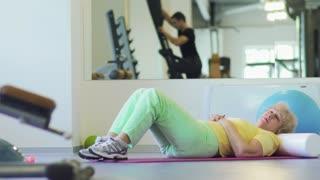 Elderly woman fell asleep in the gym