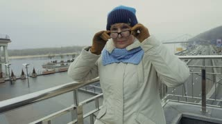 Elderly woman in glasses at viewpoint