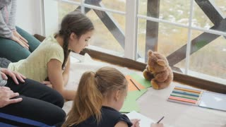 Family drawing pictures and spend time together at home