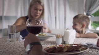 Family eating in restaurant