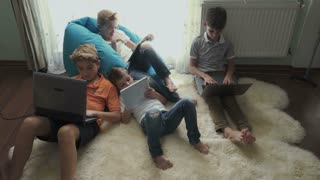 Family of brothers uses electronic gadgets at home