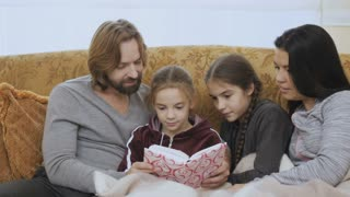 Family reads the book together