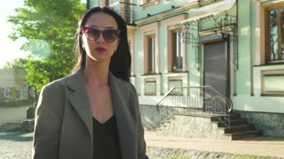 Fashionable woman walking at the street in slow motion