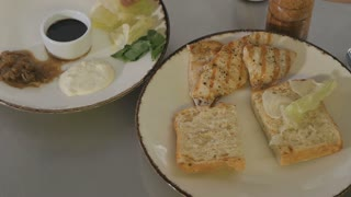 Fast shooting - cook prepare sandwich with salad, chiken fillet and sauce