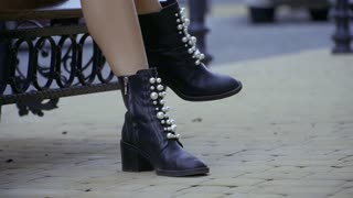 Female legs in black shoes