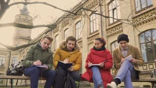 Four friends students discusses the exams