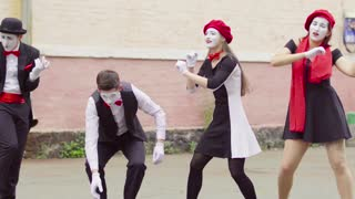 Four mimes play on invisible musical instrument