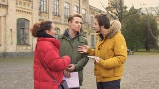 Friends meet their friend standing near university