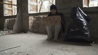 "Frozen hungry homeless with cardboard ""help"