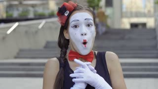 Funny girl mime scary and fear something