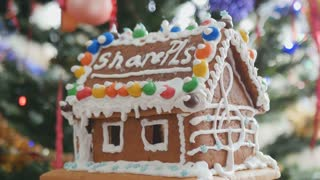 Gingerbread house with cream treble clef at the side