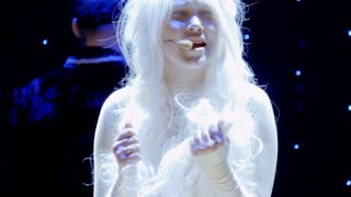 Girl albino and girl with beard sing song on stage in theatre
