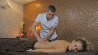 Girl laying on the massage table and enjoying the procedures