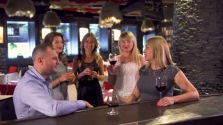 Girls get acquainted with a man at restaurant