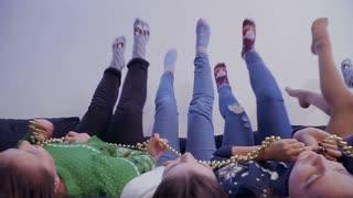Girls lying upside down moving their legs