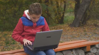 Grandfather forbid a grandson to use computer outdoors in park