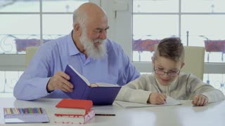 Grandfather help grandson to make the home work