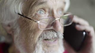 Gray-haired senior man talking on phone