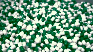 Green and white medical capsules