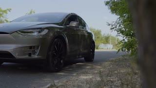 Grey luxury car near road