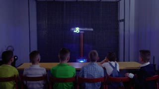 Group of children watching the experiment with musical tesla coil