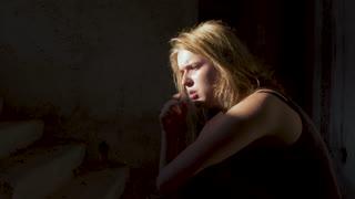 Grumpy girl is smoking in the basement