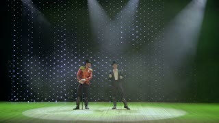 Handsome gentlemen dancing on stage in theatre