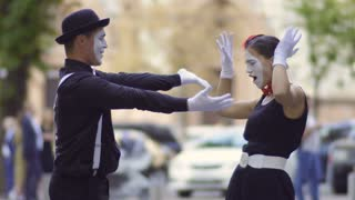 Handsome man mime invite his girlfriend on the date