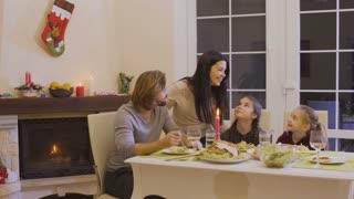 Happy family celebrates christmas at the festive table