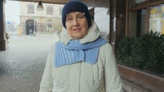 Happy granny at the street