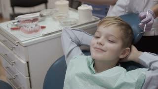 Happy little boy in dentist chair