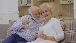 Happy old couple with keys from a new house