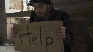 "Hungry ill homeless with cardboard ""help"