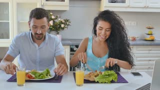 Husband and wife have breakfast at the kitchen