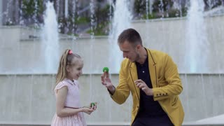 Illusionist show magic trick with balls to a little girl