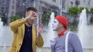 Illusionist showing trick with ring and rope for the mime