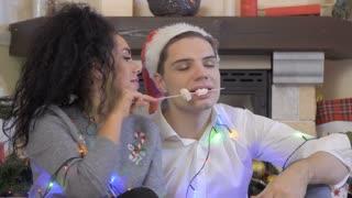 In love couple eats marshmallows