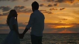In love couple enjoys the sea sunset