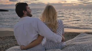 In love couple quarrels near the ocean