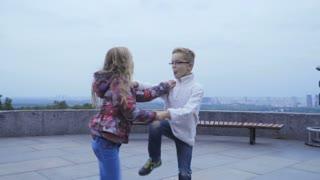 Kids dancing fast dance outdoors