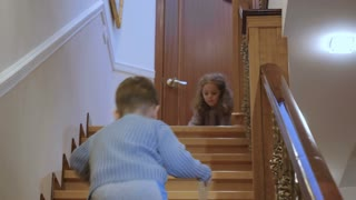 Kids play near the stairs