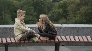 Kids share secrets outdoors