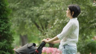 Lady takes pills near the baby carriage