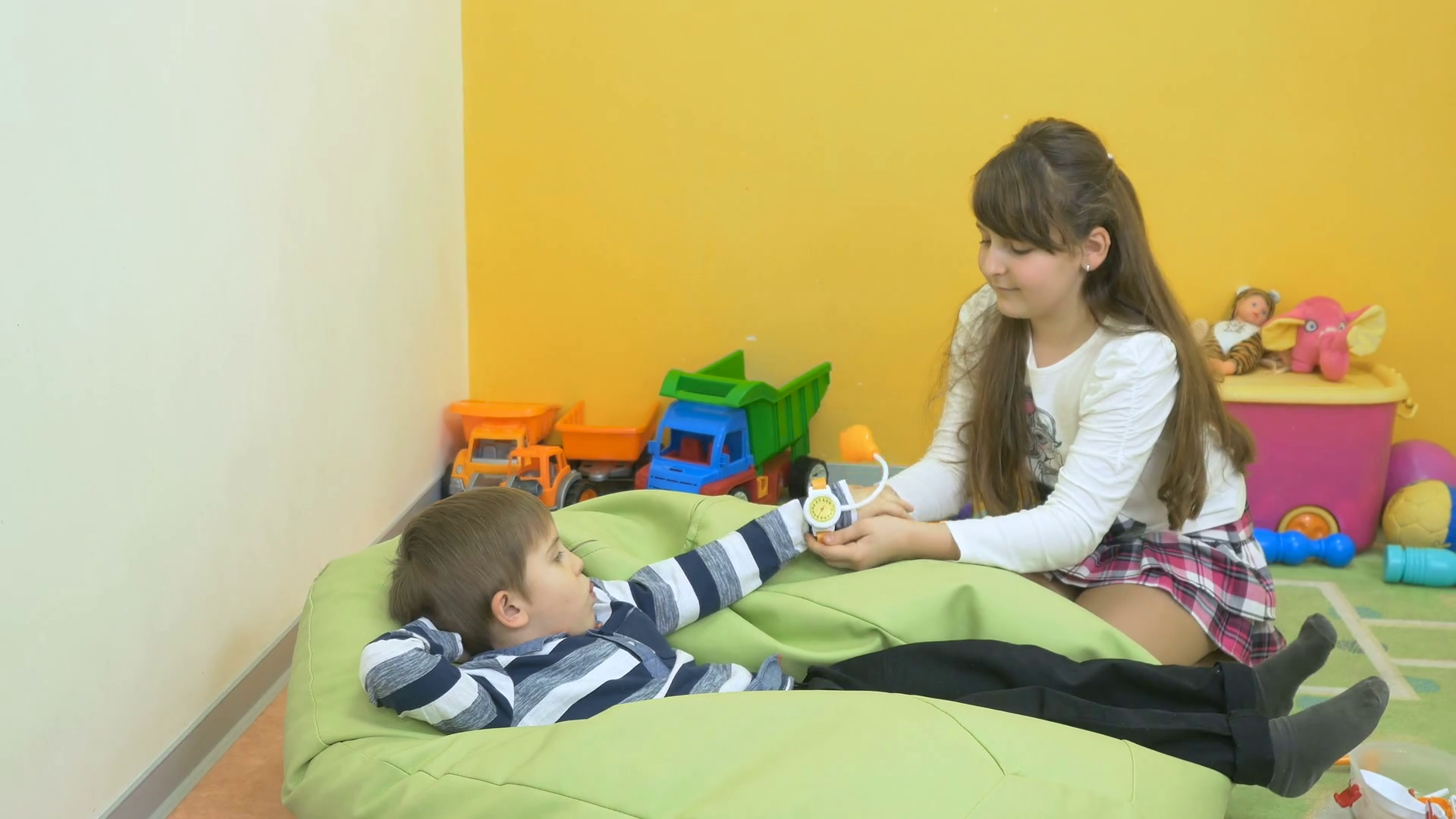 Little boy and girl playing with toy tonometer in the room Stock Video Footage - Storyblocks