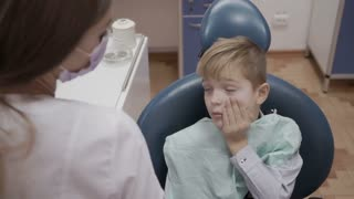 Little boy complain dentist about the toothache
