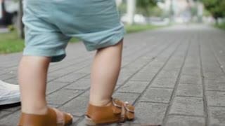 Little boy learns to walk