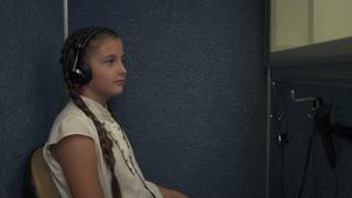 Little girl undergoes a hearing test